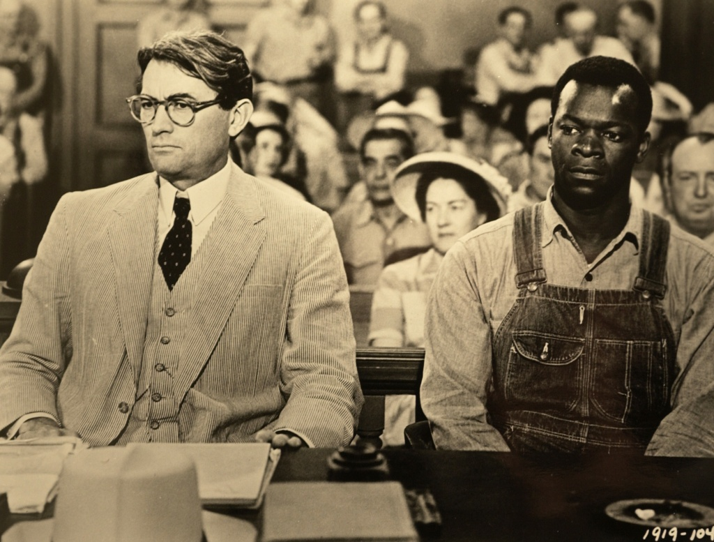 the similarities between an innocent mockingbird and the characters of atticus finch boo radley and
